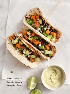 Sweet Potato Avocado Tacos make an easy, lightly spicy & fun weeknight dinner! Stuffed with chile-roasted sweet potatoes, avocado, black beans & feta, they're delicious topped with avocado-yogurt lime sauce. Gourmet Sandwiches, Gourmet Burger, Mexican Food Recipes, Vegetarian Recipes, Dinner Recipes, Cooking Recipes, Healthy Recipes, Delicious Recipes, Easy Recipes