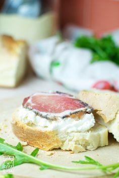 Lonzu, goat cheese and arugula