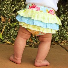How to Sew Fancy Ruffled Diaper Covers - cute pattern (to be purchased) with instructions either with or without a serger.  Would be such a cute gift with a matching top.