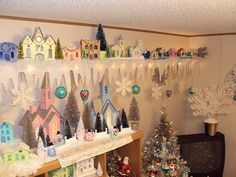 Christmas village setup... a long shelf would be ideal to hold a collection.