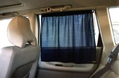 $29.00 Baby Car Window Shade (White) - PORTABLE ADJUSTABLE CURTAIN  For Cars, Vans, Trucks, SUVs, Boats, RVs,............    Protects the passengers from heat and harmful Sun rays.    An ideal product to have in any car.  There are many types of auto sunshades in the market today, but none as  conveniently adjustable as this polyester mesh curtain.    It quickly sticks on a side window by two strong suct ...