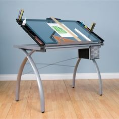 Studio Designs' Futura Craft Station is great for drafting,drawing, or crafting on its large tempered safety-glass worksurface. The table top angle adjusts up to 35 degrees. Color: Silver frame with blue glass top. Woodworking Quotes, Woodworking Desk, Woodworking Projects, Woodworking Organization, Intarsia Woodworking, Woodworking Videos, Organization Ideas, Bauhaus, Drawing Desk