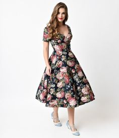 The Maria Woodland Bloom Dress freshly plucked from Collectif is a winter wardrobe essential! This breathtaking 1950s dr...Price - $98.00-gA1VbbGR