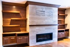 Premise Design Family Room Fireplace and Built-in. Walnut cabinets with travertine fireplace
