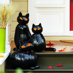 Tutorial for Black Cat Lanterns made from stacked pumpkins.
