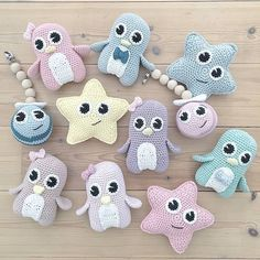 Pastel color toy owls and stars for baby.
