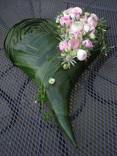 blushpink ranunculus, silverblue eryngium, deepgreen aspidistra sympathy heart…
