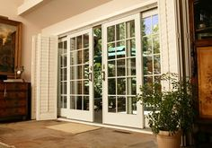 like this slider...smart design. the look of french doors with the space saving feature of a slider. Best of both worlds.