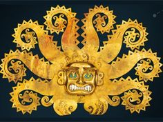 An ornament shaped Moche hybrid half-cat, half-octopus animal.