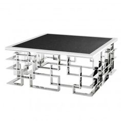 Part of the stunning Eichholtz range, this coffee table has a silver polished stainless steel architectural structured base that supports a solid black granite top. A glamorous coffee table that will compliment any living room, it will be sure to charm gu Granite Tops, Black Granite, Steel Coffee Table, Coffee Tables, Table Furniture, Furniture Stores, Luxury Living, Room Inspiration, Kitchen Dining