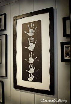 DIY Family Handprint Wall Art. Love how she used white crayon to write the kids' names and ages. Tutorial from Creatively Living here.