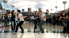 Love the looks on the faces of the other travelers as the mob takes over. Denver Airport Swing Dance Flash Mob