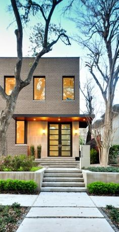 architecture Southampton Residence is the first home for a young family recently transplanted to Houston from a major US city. The homeowners wanted a brick house designed as a modern in Modern Brick House, Brick House Designs, Modern House Design, Modern Door, Architecture Design, Classical Architecture, Residential Architecture, Installation Architecture, Building Architecture