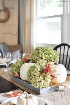 White pumpkins, dried hydrangeas, and fallen leaves combine to make a classically elegant centerpiece.