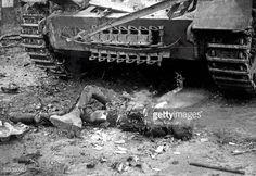 The still-burning corpse of a soldier can be seen in front of a ...