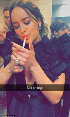 Caution to the wind: Dakota Johnson was one of the many stars snapped breaking the New York smoking ban as pal Rita Ora captured her enjoying a smoke in the bathroom at the Met Gala on Monday