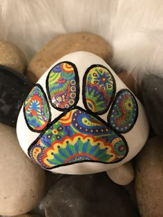 Paw print painted rock by PinkaboutitGifts on Etsy https://www.etsy.com/listing/516177214/paw-print-painted-rock