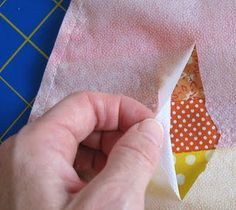 I can't wait to try this method of applique. So much easier than using a glue stick and rolling the edges by hand.