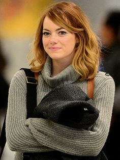 Emma Stone is back to New York City on Monday afternoon, arriving to New York's JFK Airport in a cozy sweater.
