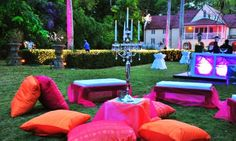 Emma Corrie Porters Great House Wedding Venue in Barbados with Jewel Tone Décor. pink and orange lounge area