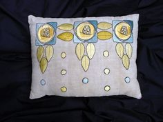 Vintage Arts and Crafts Embroidered Linen Pillow with three Mackintosh inspired stylized rose designs in shades of blue, yellow, gold and green. SOLD