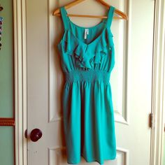 Turquoise casual dress Hello miss  turquoise casual dress w/ ruffles at top. Comfortable and very flowy. Great for summer weather. Light. 100% polyester Hello miss Dresses