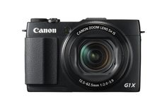 """Canon PowerShot G1 X Mark II Digital Camera - Wi-Fi Enabled. 13.1 megapixel at 4:3 / 12.8 megapixel at 3:2 aspect ratio 1.5""""-type CMOS sensor. 24-120mm equivalent F2-3.9 lens with optical image stabilizer (5x optical zoom). ISO 100-12800. Dual control rings. 3"""" tilting touch LCD with 1,040,000 dots. 1080/30p HD video. Optional electronic viewfinder with 2,360,000 dots (sold separately). Raw and Raw+JPEG shooting. SD/SDHC/SDXC memory. Built-in Wi-Fi, NFC, and GPS."""