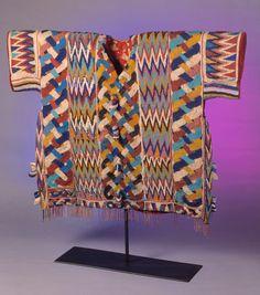 Kings Tunic Agbada Ileke  Artist/ Origin: Yoruba Peoples  Region: Nigeria: Ijebu Region, Kingdom of Owo  Period: circa late 19th century- early 20th century  Material: glass beads, cloth  Dimensions: 35 x 48 x 6 1/2 in  On view in the museum