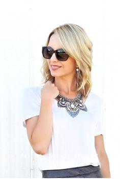 Add some sparkle with a statement necklace! Tiaras and Heels blog
