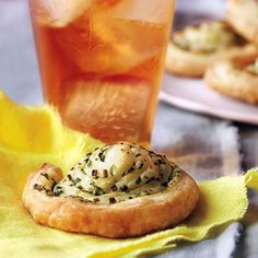 These garlicky, herby pastries are ready to party. Serve this appetizer with the classic Gin Sling cocktail for a delicious pairing.