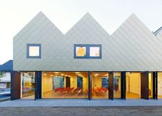 The consecutive pitched roofs of this church community centre in Germany were designed by Netzwerkarchitekten to resemble a row of terraced houses.