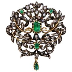 Georgian Emerald and Diamond Silver Over Gold Brooch. An antique Georgian period brooch with diamonds and emeralds set in silver on top of gold. There are approximately 2.50cts in emeralds and approximately 1.75cts in uncut diamonds. Early 1800s