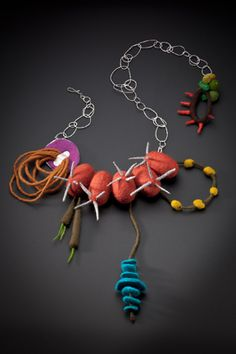 Necklace | Sarah Fox.  'Joann'  Sterling silver and felted wood