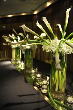 Calla Lilies with baby's breath centerpieces on top of mirrors