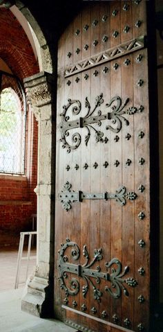Old wood door with hinges                                                                                                                                                                                 More