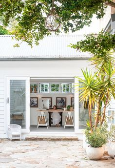 Stylish home office and desk with large doors to courtyard of a white coastal Mediterranean style home on Sydney's northern beaches. #courtyard #whitecourtyard #coastalstyle #crazypaving #coastalhome #mediterraneanstyle #homebeautiful Crazy Paving, Granny Flat, Southern Italy, Mediterranean Style, Coastal Homes, Pool Houses, Coastal Style, Home Office, Beach House