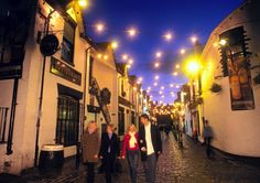Ashton Lane, Glasgow, Scotland. If ever in Scotland THIS is the place to be for pubs and eateries. :-)