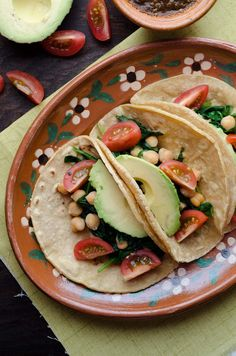 This recipe for Chickpea and Spinach tacos is my go-to easy lunch. Serve on warm corn tortillas topped with cherry tomatoes avocado salsa and pepitas. Vegan Mexican Recipes, Vegetarian Recipes Dinner, Delicious Vegan Recipes, Vegan Dinners, Yummy Food, Vegan Tacos, Recipe For Mom, Cooking Recipes, Corn Tortillas