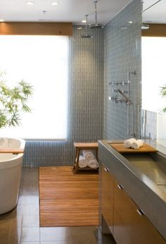 great concrete sink and vanity, wooden slotted floor in OPEN shower area with two overhead faucets