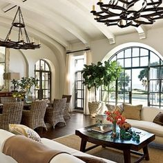 Barrel vaulted ceiling, iron chandeliers, wicker dining chairs..