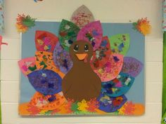 Turkey board. Give the kids anything to decorate the feathers with :) And let them go for it. Its fun and easy. Did this craft with my 2 year olds.