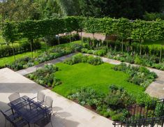 Formal garden with patio and herbaceous borders
