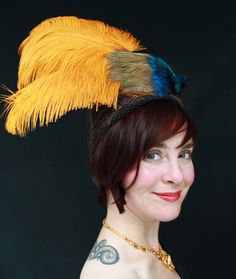 1930s-style black felt turban hat with vintage veiling and wild faux Bird-of-Paradise decoration.