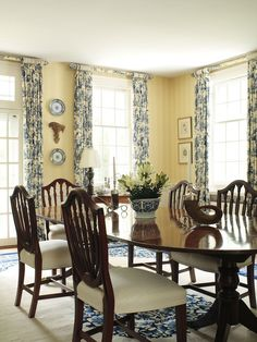 Butter yellow walls with blue and white decor--my fav color combo in the whole world! This dining room has my name all over it!
