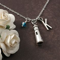 Hey, I found this really awesome Etsy listing at https://www.etsy.com/listing/258254354/lighthouse-necklace-initial-birthstone