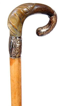 """Victorian Horn Dress Cane- Ca. 1875- A prime example of a Victorian twisted horse and gold-filled handle, malacca shaft and horn ferrule. H.- 4 ½ x 3"""" O.L.- 35"""""""