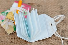 Cute idea to add hidden/ extra journaling - fold a tag with papers inside to make a dinky book! Crate Paper blog, Tami