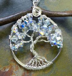 This beautiful Mini/Petite/Small sparkling Tree of Life Pendant is hand wire wrapped with Brilliant Swarovski Clear AB Crystals using .925 Sterling