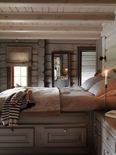 'Love the soft, calming tones used in this cabin bedroom.'