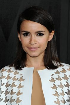 Miroslava Duma attended the Miu Miu fashion show wearing a simple side-parted 'do.